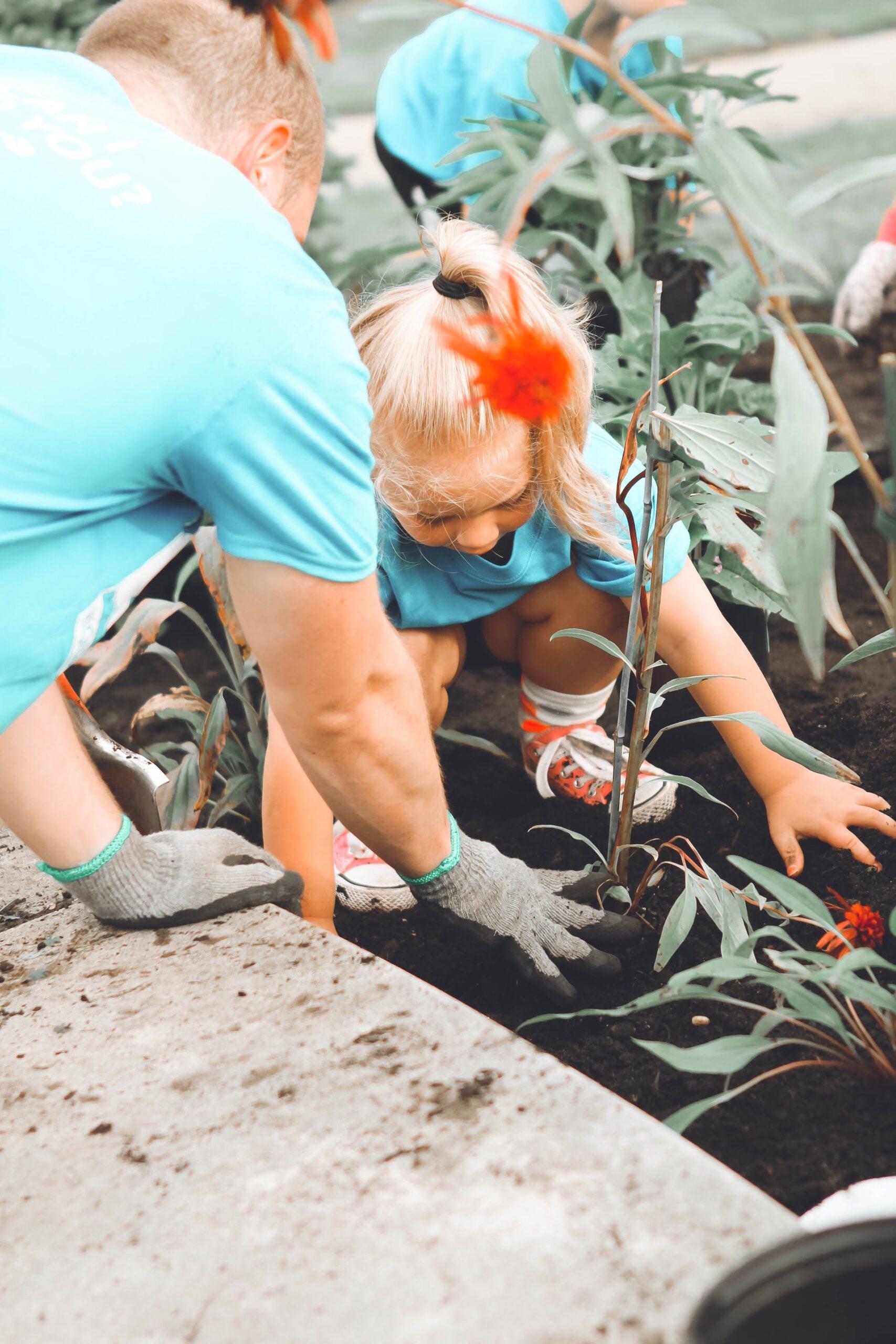Man helping girl by volunteering. Photo by Anna Earl on Unsplash
